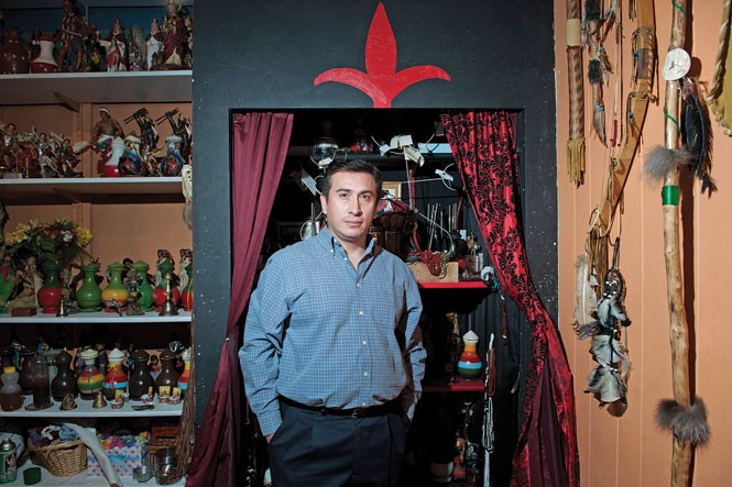 "Andres Aquino, owner of Botanica Santa Barbara Bendita, doesn't venerate Santa Muerte, but he respects her, he says. He views her explosion in popularity as having grown on the back of the drug trade in Salt Lake City. ""If you want to sell dope, you have to have good protection.""  And for those who believe, ""There's none better than La Santisima."" - NIKI CHAN"