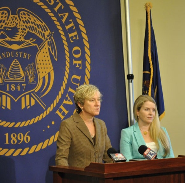 Attorney Laura Milliken Gray, left, speaks in defense of same-sex adoptions at a Feb. 28 press conference. - COLBY FRAZIER
