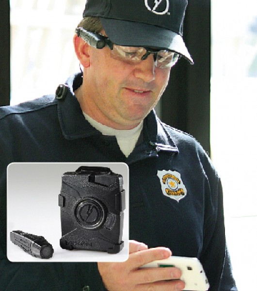 Detective Bill Silver of the Salt Lake City Police Department demonstrates the AXON Flex body camera. SLCPD has 95 of the camera - SLCPD