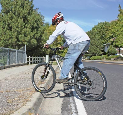GETTING OVER A CURB IS ALL A MATTER OF TIMING. WITH PEDALS LEVEL AND YOUR BUTT OVER THE BACK OF THE SADDLE, LEAN BACK SLIGHTLY AND PULL THE HANDLEBARS UP AS YOU REACH THE CURB - BY WINA STURGEON