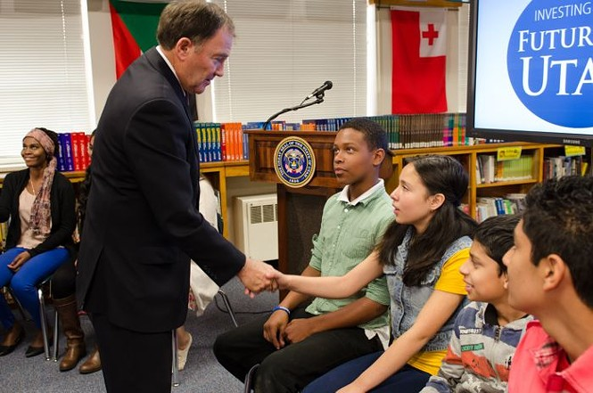 Gov. Herbert greets students at Granite Park Junior High School. He proposes spending $5.8 billion on education in 2015.
