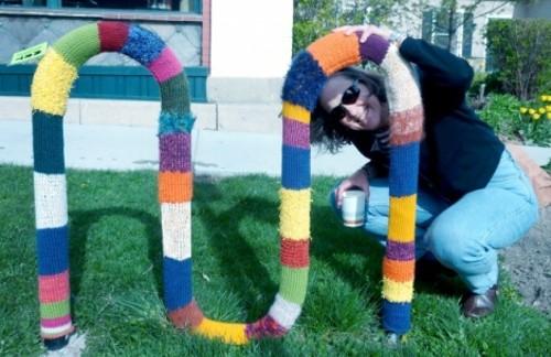 Lisa Sewell with her Jack Mormon Coffee yarn bomb