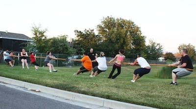 MILITARY BOOT CAMP CLASSES USE BOTH THE INSIDE AND OUTSIDE OF THE GYM. TUG-OF-WAR IS JUST ONE OF THE GROUP EXERCISES - WINA STURGEON