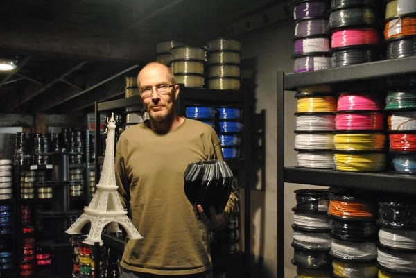 Nicco Macintyre of Zeni Kinetic displays a few creations from his company's 3-D printer