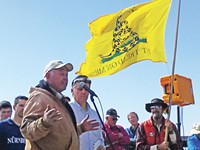 San Juan County commissioner Phil Lyman listens as a speaker addresses the crowd at the ATV rally - ERIC TRENBEATH