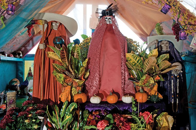 "Santa Muerte is ""muy cabrona, muy macha. If you do everything right, if you are a believer, she'll protect you."" - —Alvina Tavera, owner of Botanica San Antonio, whose altar in honor of Santa Muerte is pictured - NIKI CHAN"