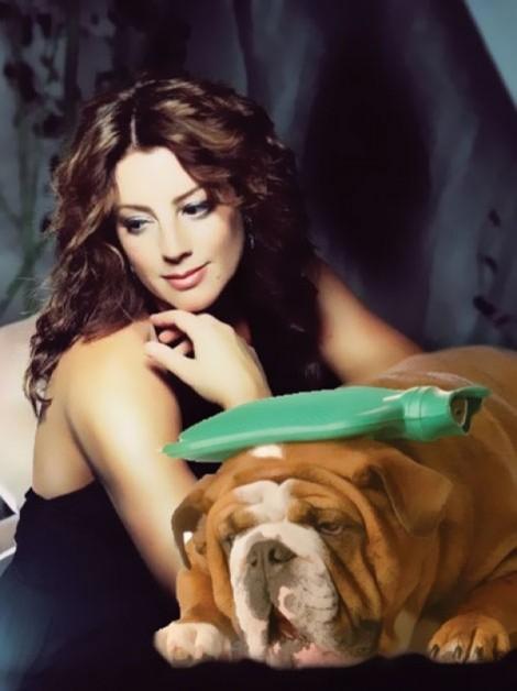 Sarah McLachlan comforts a sick puppy.
