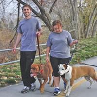 Taylor & Justine Lake walk their mastiff, Bell, and pit bull, Kingsley, along the Jordan River Parkway.