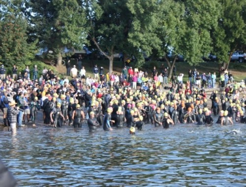 The mass start of the XTERRA off-road tri swim at Pineview Reservoir - WINA STURGEON