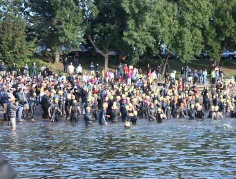 The mass start of the XTERRA off-road tri swim at Pineview Reservoir - WINA STURGEON