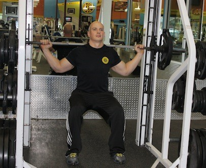 THE SMITH MACHINE ALLOWS YOU TO CHOOSE WHICH MUSCLES WORK MOST IN A SQUAT. AN UPRIGHT POSTURE PUTS MORE RESISTANCE ON THE BACK. FEET FORWARD WORKS THE CORE. PUT MORE PRESSURE ON THE INSIDE OF ONE FOOT AND OUTSIDE OF THE OTHER, THEN SWITCH TO WORK THE ADDUCTORS AND ABDUCTORS. - BY WINA STURGEON