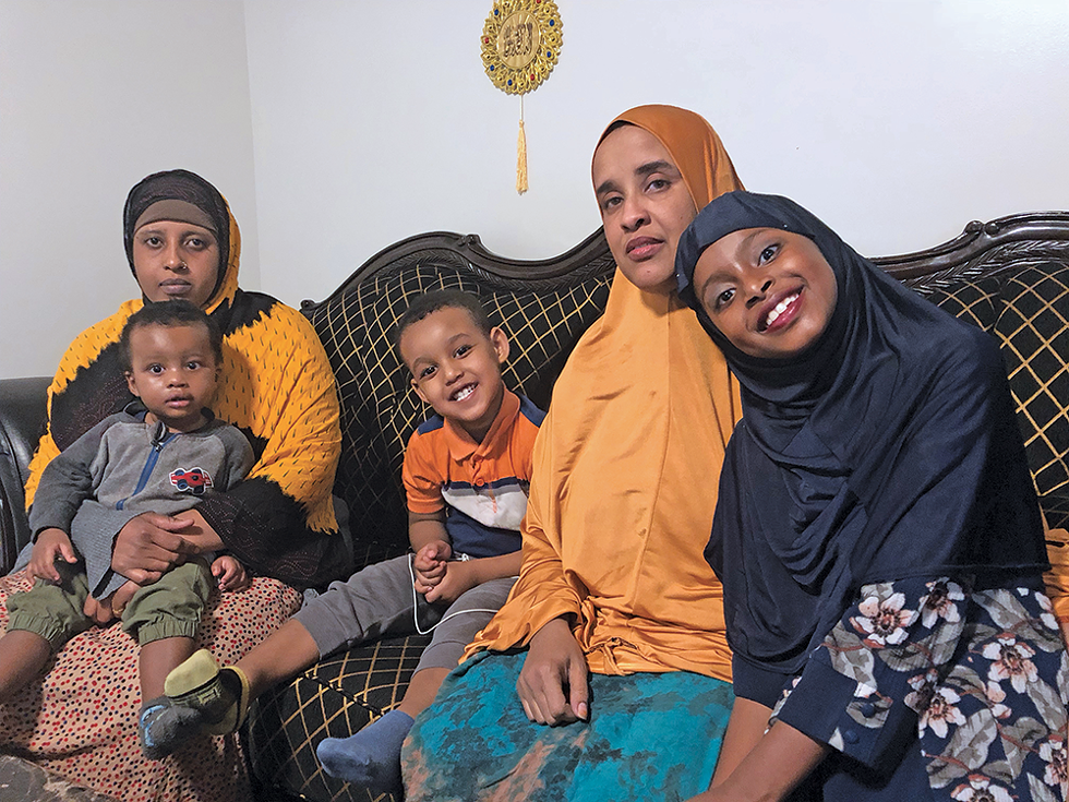 """Sadia Osman (second from right) raises a 3-year-old son and spends a lot of time with her cousin and her children, but she misses her boys every day. """"We have everything, but we miss part of our lives, like our kids,"""" she says of refugees resettled in the U.S. - KELAN LYONS"""