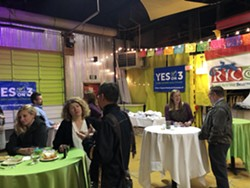 A scene from the Yes on Prop 3 election night party. - KELAN LYONS