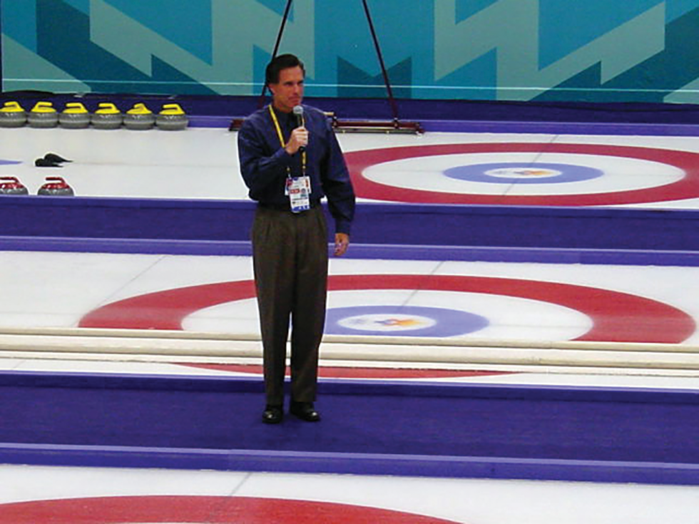 CEO of the Salt Lake Organizing Committee, Mitt Romney—in all his pleated-pants glory—says a few words before a curling event at the 2002 Games. - UNCLEWEEK VIA WIKIMEDIA-COMMONS