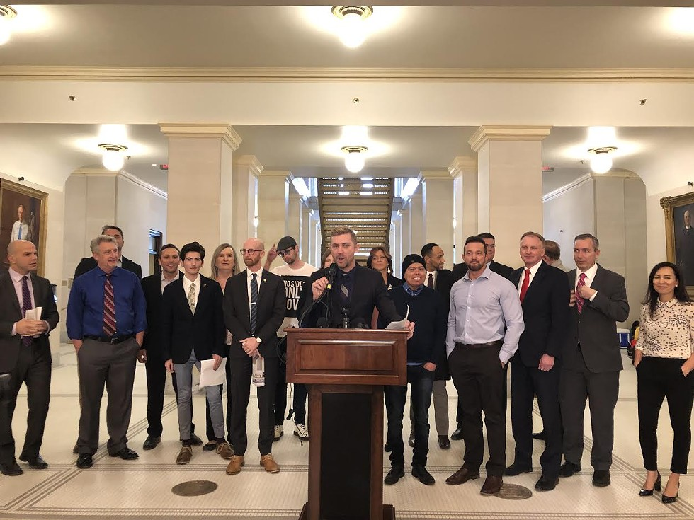 """""""We are raising the consciousness of this state on what we can do to help prevent suicide,"""" Equality Utah's Troy Williams, center, said. - KELAN LYONS"""