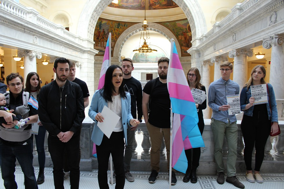 """""""It does feel like we're being written out, especially as a transgender youth,"""" Ermiya Fanaeian, center, said on Monday. - RAY HOWZE"""