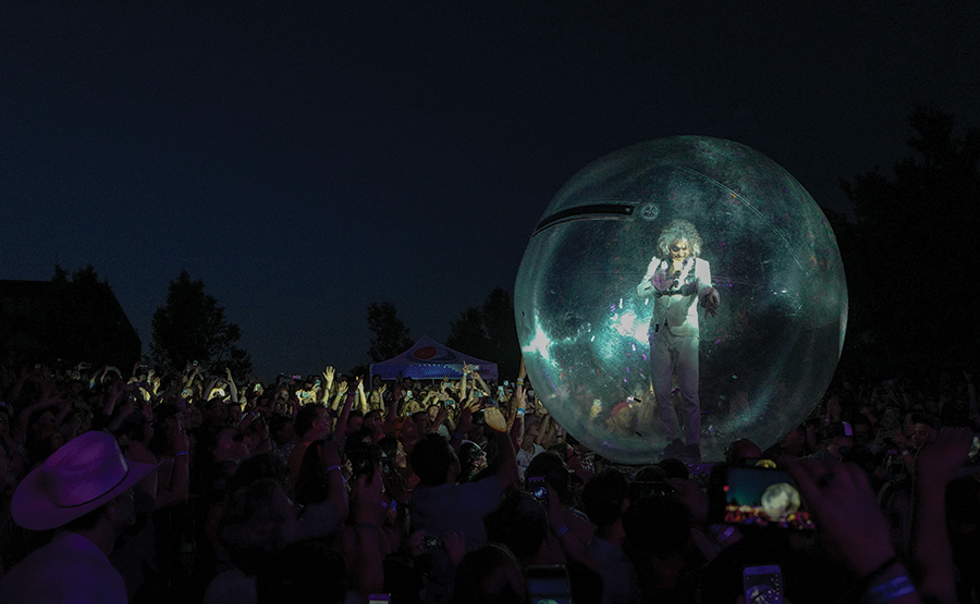 The Flaming Lips' Wayne Coyne being his Wayne Coyniest during last year's Ogden Twilight kickoff. - STEVE CONLIN
