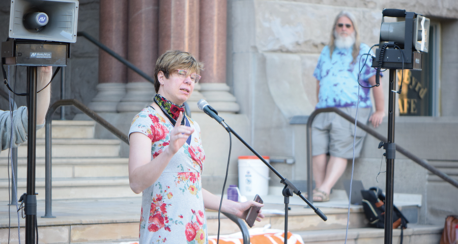 Amie Annsa describes her experiences with homelessness to the crowd gathered outside the City and County Building ahead of a recent City Council meeting regarding single-room occupancy units. - RAY HOWZE