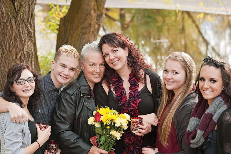 Kimberly Hansen-Ennis, center-right, and her wife, Kelli, with their family - COURTESY PHOTO