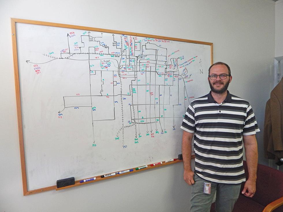 Eric Callison, UTA's manager of service planning, maps out Salt Lake City's transit system. - PETER HOLSLIN