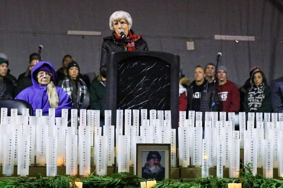 Pamela Atkinson, center, speaks during the annual Homeless Persons Memorial candlelight vigil. - JENNIFER GUZMÁN