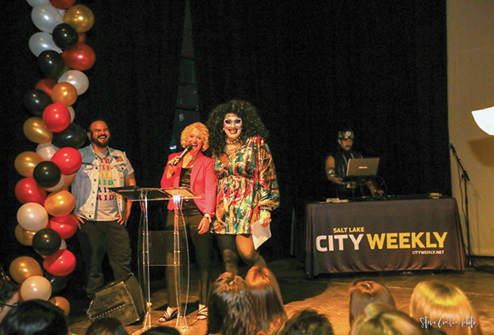 """Flanked by CW editor Enrique Limón, and another famous Jackie, drag superstar Jackie Beat, Mayor Jackie Biskupski proclaims this publication a """"community asset"""" during the 10th annual Miss City Weekly. - STEVE CONLIN"""
