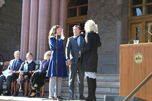 Mendenhall, accompanied by husband Kyle LaMalfa, is administered the oath of office on Monday outside the City and County Building. - ENRIQUE LIMÓN