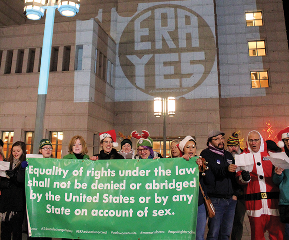 Last December, a group of merry protesters managed to project the iconic 'ERA Yes' logo on the LDS Conference Center's facade. - ENRIQUE LIMÓN