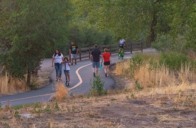 The Jodan River Parkway Trail, completed in 2017, offers a nearly continuous walking and biking path from Utah Lake to the Great Salt Lake. - JORDAN ALLRED
