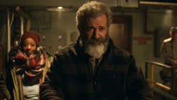 Marianne Jean-Baptiste and Mel Gibson in Fatman - SABAN FILMS