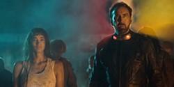 Sofia Boutella and Nicolas Cage in Prisoners of the Ghostland - RLJE FILMS
