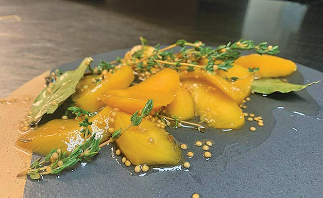 """A Red Haven peach is firm, but """"bleeds"""" juice, says chef Rob Perkins of Franck's. - CAROLYN CAMPBELL"""