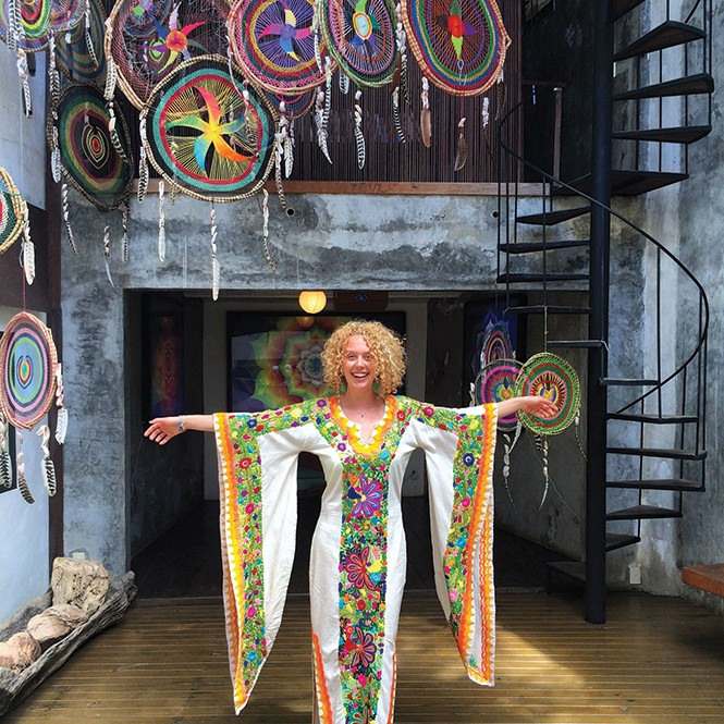 Nora Heilman in a hand-embroidered wedding gown at Pachamama