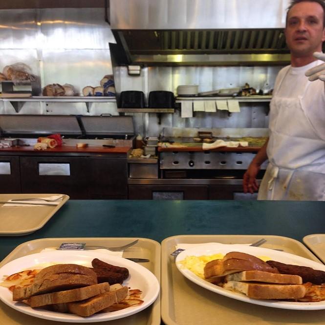 Deno Priskos mans Royal Eatery's grill prior to the establishment's July 2 closing. - ENRIQUE LIMÓN
