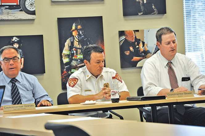 Former UFA Fire Chief Michael Jensen (center) at a July 19 closed-session meeting. - COLBY FRAZIER