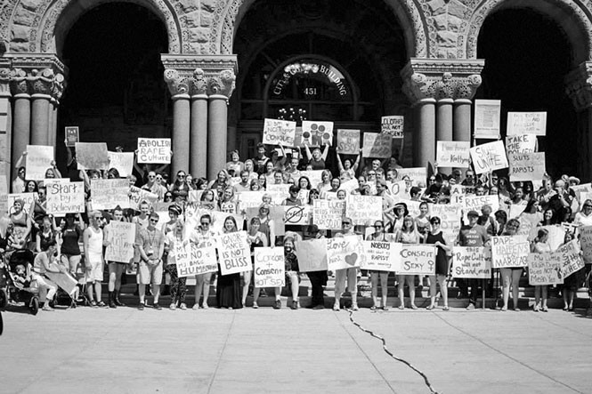 Participants of SlutWalk 2014 pose in front of Salt Lake City and County Building - FACEBOOK.COM/SLUTWALKSLC