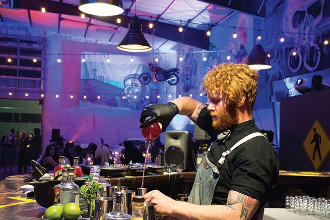 Zaid Womack mixing up the perfect apocalyptic cocktail