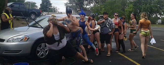Anarchy Girls Cospace grand opening event, Cosplay Carwash, (right to left) Stephen Burress, Nathan Sims, James C Carlson, Madison Lindgren, Elly Swedberg, Zack Sims, Sarah Jane Eaton, Morgen Yoakum, Noelle Cummings, - DERRICK HAMPSON