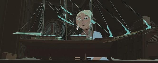 Sasha (Chloe Dunn) studies a model of her grandfather's ship, the Davaï - SHOUT! FACTORY FILMS