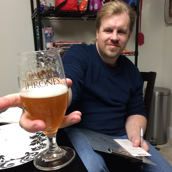 My friend Mark, enjoying the brew and winning at the game.