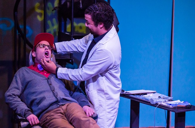 The Dentist (Bradley Hatch) giving Seymore (Kurt Christensen) a check-up in Little Shop of Horrors. - DAVID SULLIVAN