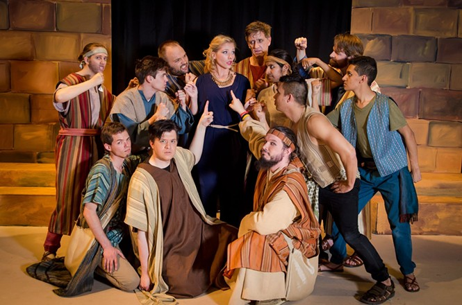 The Narrator (Melissa Holm) surrounded by Brothers in Joseph and the Amazing Technicolor Dreamcoat. - JENNY MAHLER