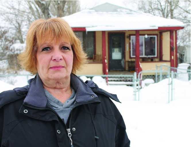 Heidi Jones-Asay stands in front of the house where her mother was killed in late July 1970.