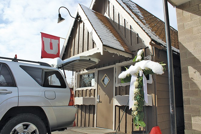 The Bar in Sugarhouse's exterior is adorned with a frosted funeral cross on Tuesday, Feb. 28, as the watering hole is packed up. - ENRIQUE LIMÓN