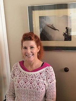 Former federal firefighter Eileen Grace in her Millcreek home. - STEPHEN DARK