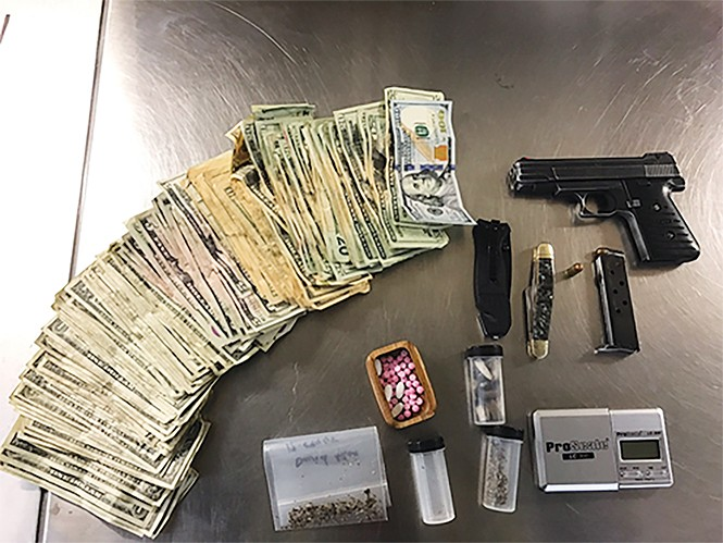 In an early April arrest of a mother and son, cops found cash, spice, pills, digital scales and a handgun. - GREG WILKING