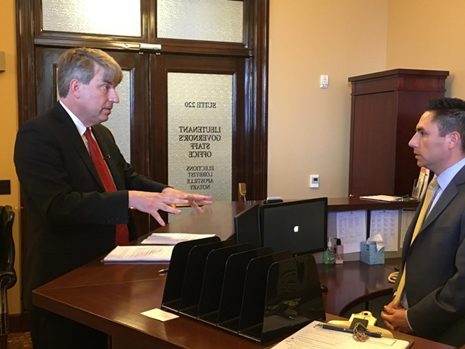 United Utah Party hopeful Jim Bennet, left, attempts to file at Director of Elections Mark Thomas' desk on Friday. - DW HARRIS