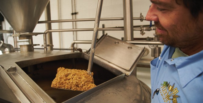 3. Templin pulls some mash from the boil.