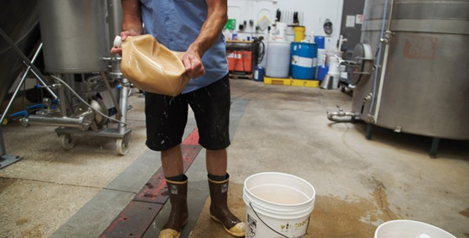 5. Brewer Andrew Rinaldo prepares yeast to be added to the fermentation tank.
