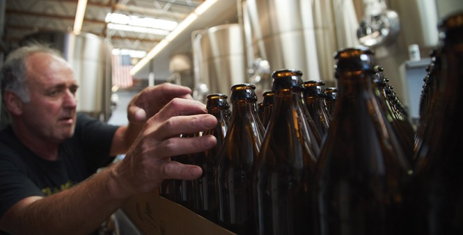 9. Dave Haley grabs a few bottles.